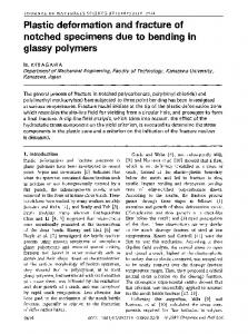 Plastic deformation and fracture of notched specimens due to bending in glassy polymers
