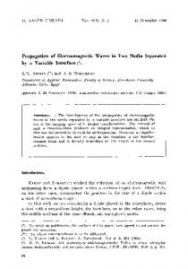 Propagation of electromagnetic waves in two media separated by a variable interface